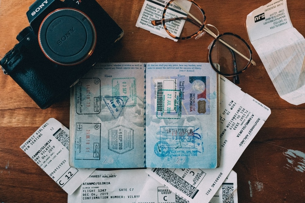 passport and tickets and camera on table